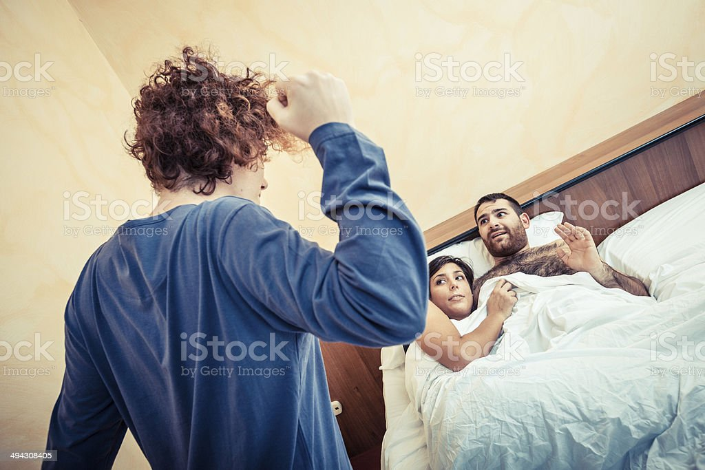 Man with Lover Caught by his Wife stock photo