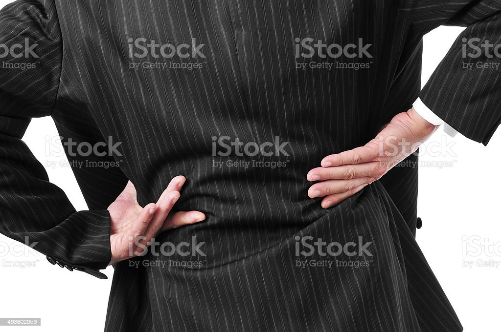 man with low back pain stock photo