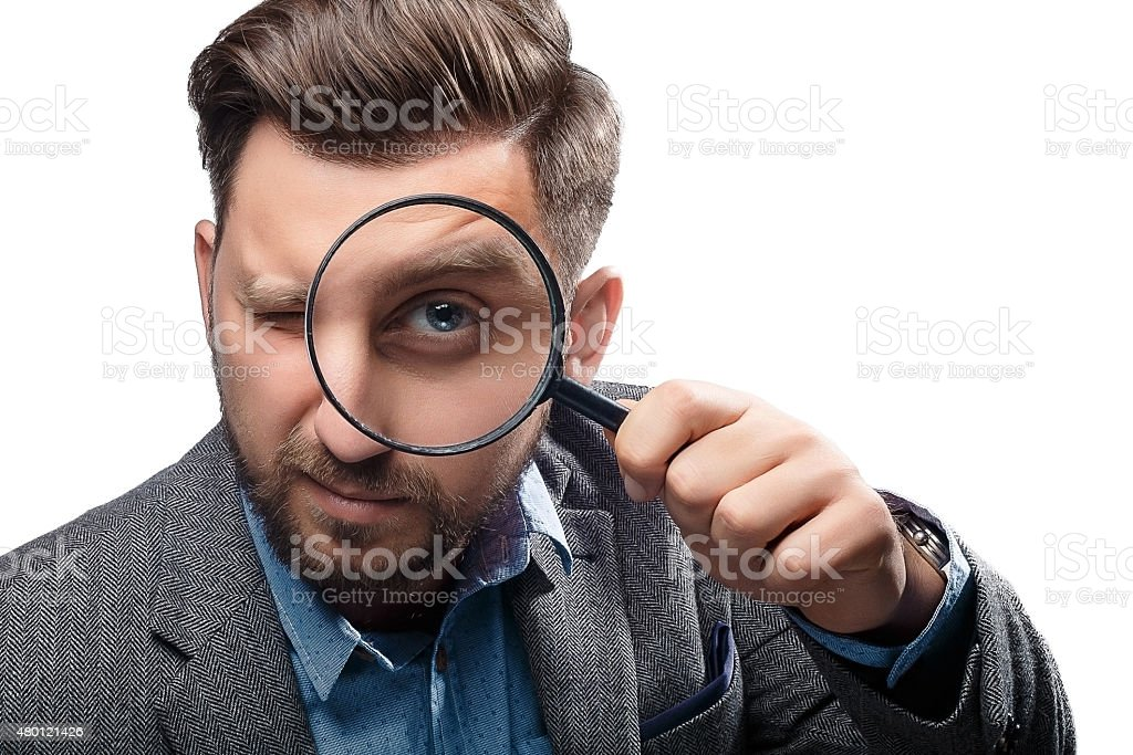 Man with magnifying glass on white background stock photo