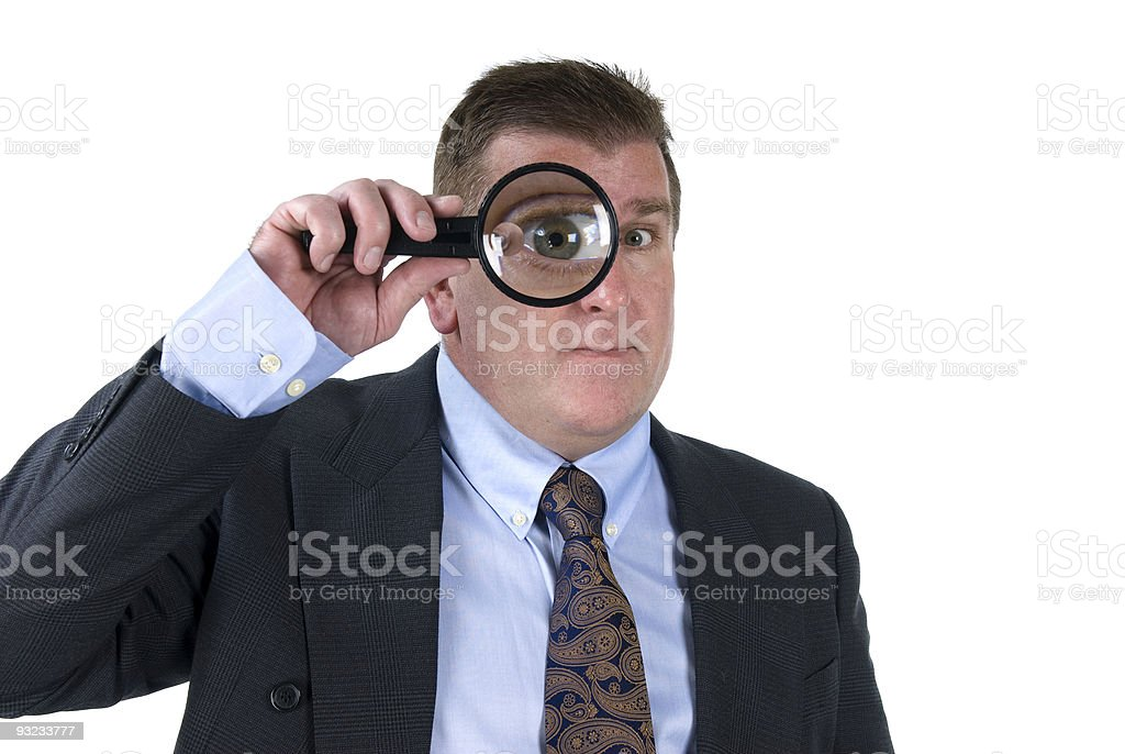 Man with magnifying glass royalty-free stock photo