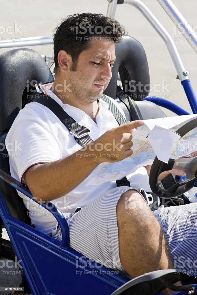 Man with map sits in buggy stock photo