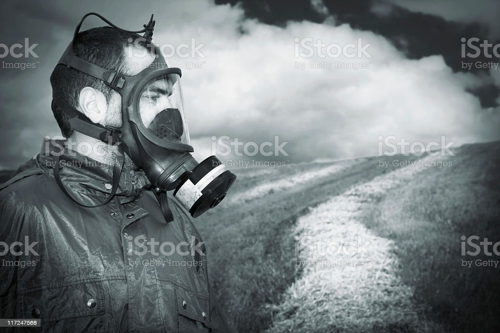 Man with mask anti gas in the field. royalty-free stock photo