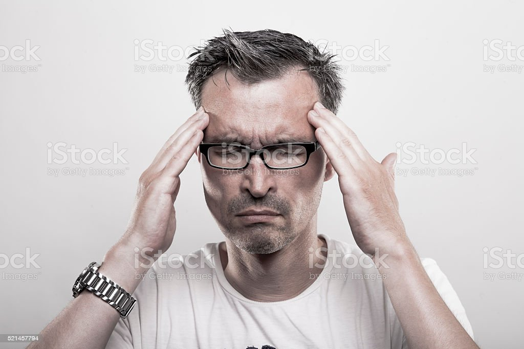 man with migraine stock photo