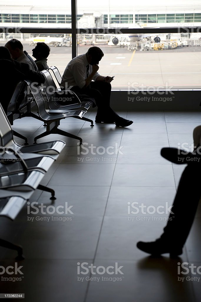 Man with mobile phone in airport royalty-free stock photo