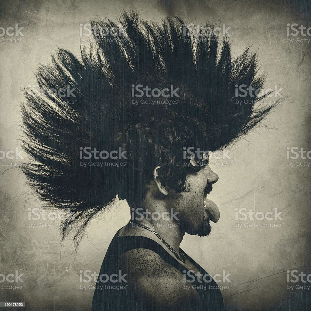 man with mohawk punk hair wig stock photo