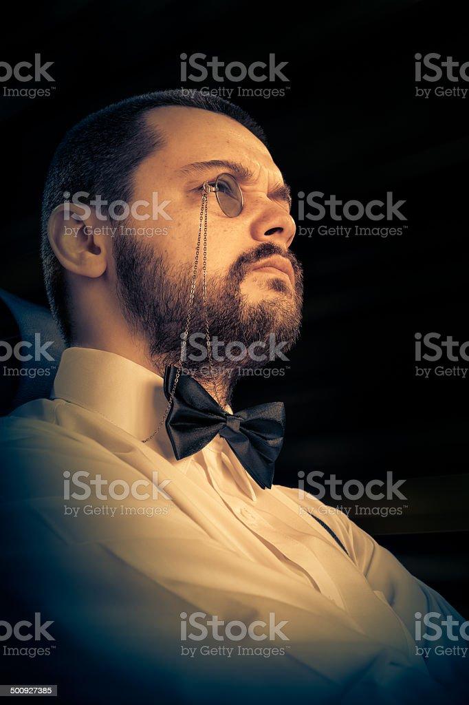 Man with Monocle and Bowtie Retro Portrait stock photo