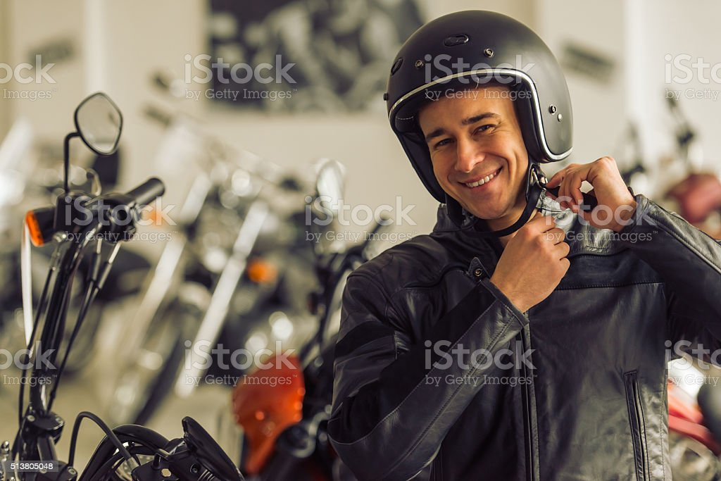 Man with motorbike stock photo