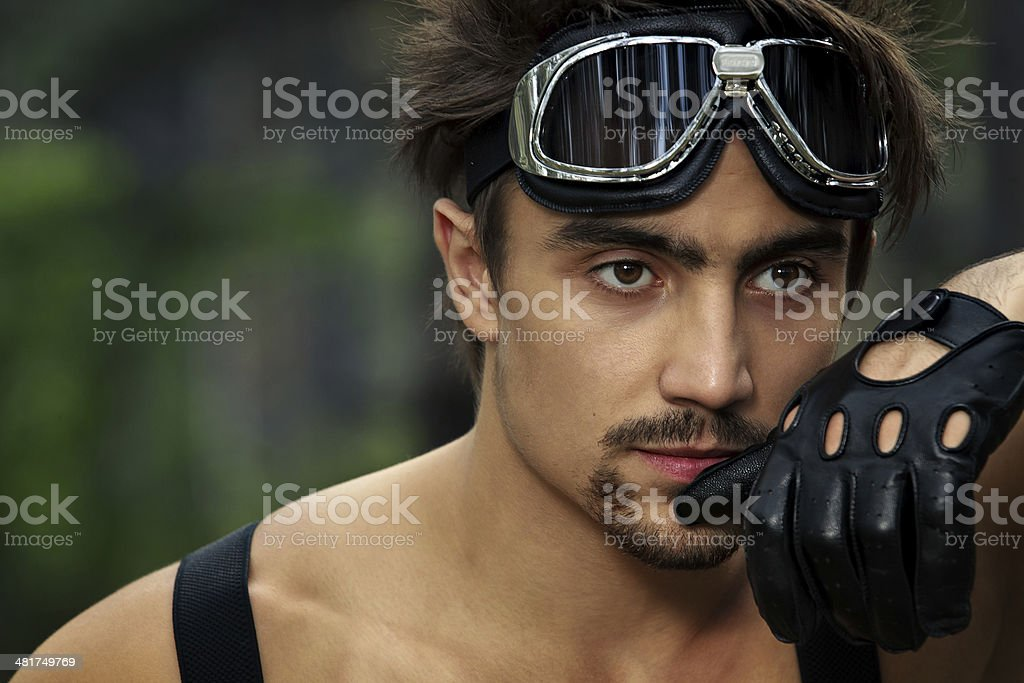 Man with motorcycle goggles and gloves stock photo