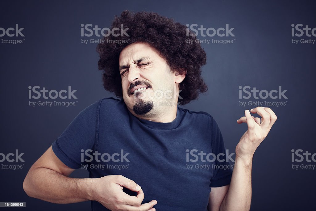 Man with moustache intensely plays air guitar stock photo