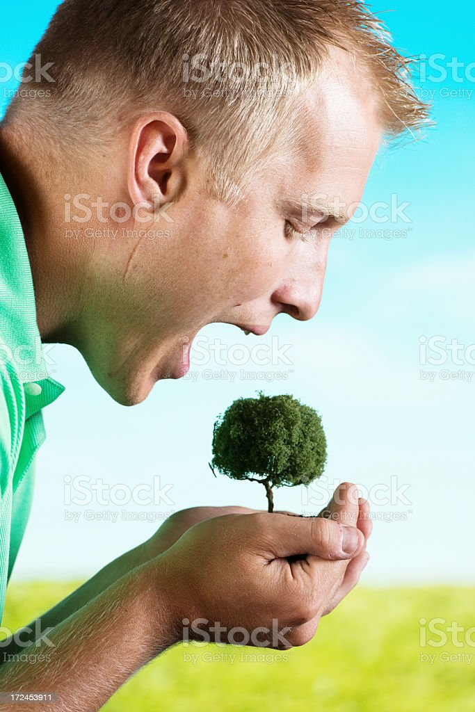 Man with mouth open over a plant royalty-free stock photo
