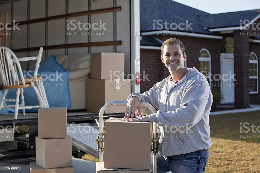 Man with moving van stock photo