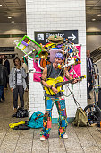 man with multiple music instruments performing at Metro station