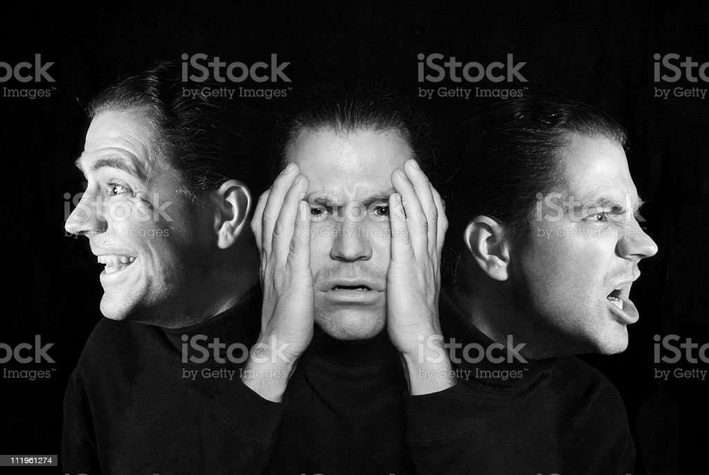Man with multiple personalities stock photo