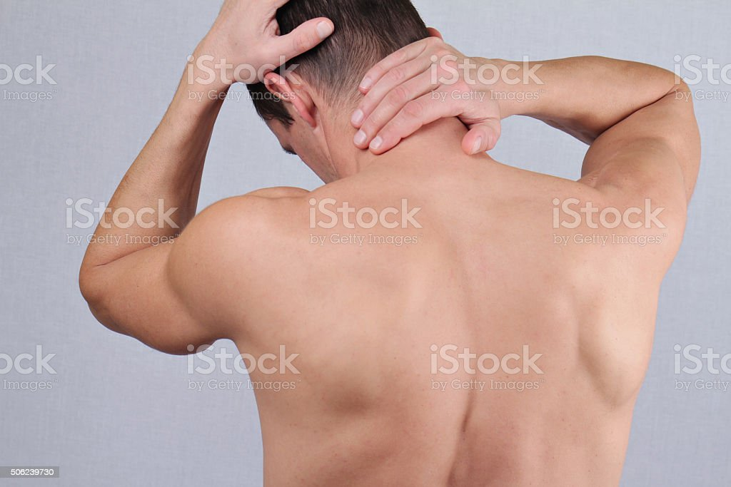 Man with neck and back pain.  Pain relief concept stock photo