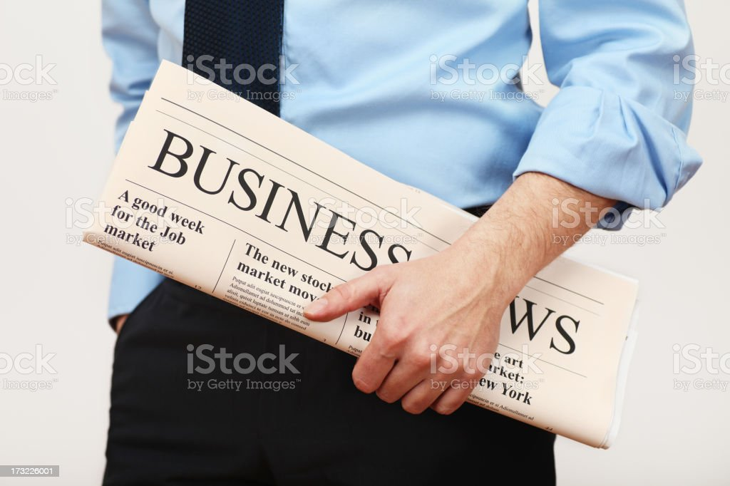 man with newspaper royalty-free stock photo