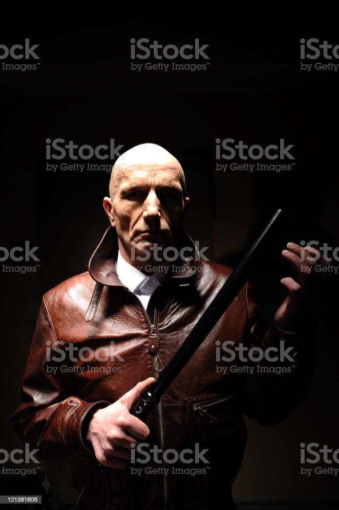 Man with nightstick stock photo