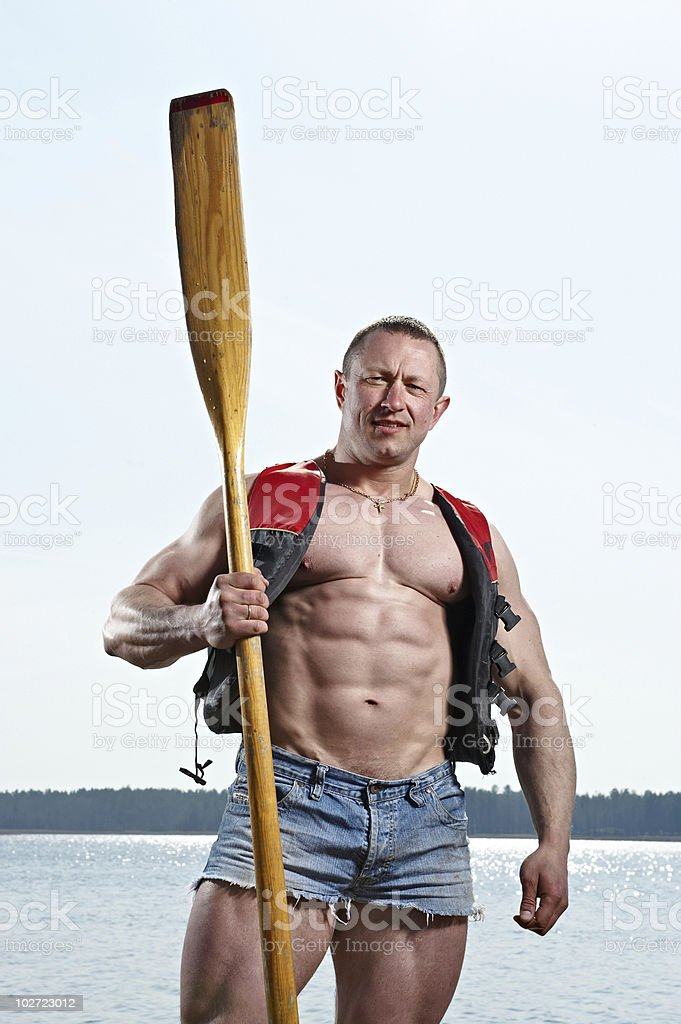 Man with oar royalty-free stock photo