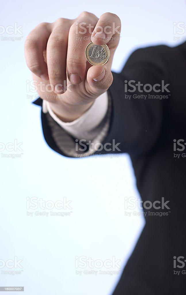 Hombre con moneda de un euro foto de stock libre de derechos