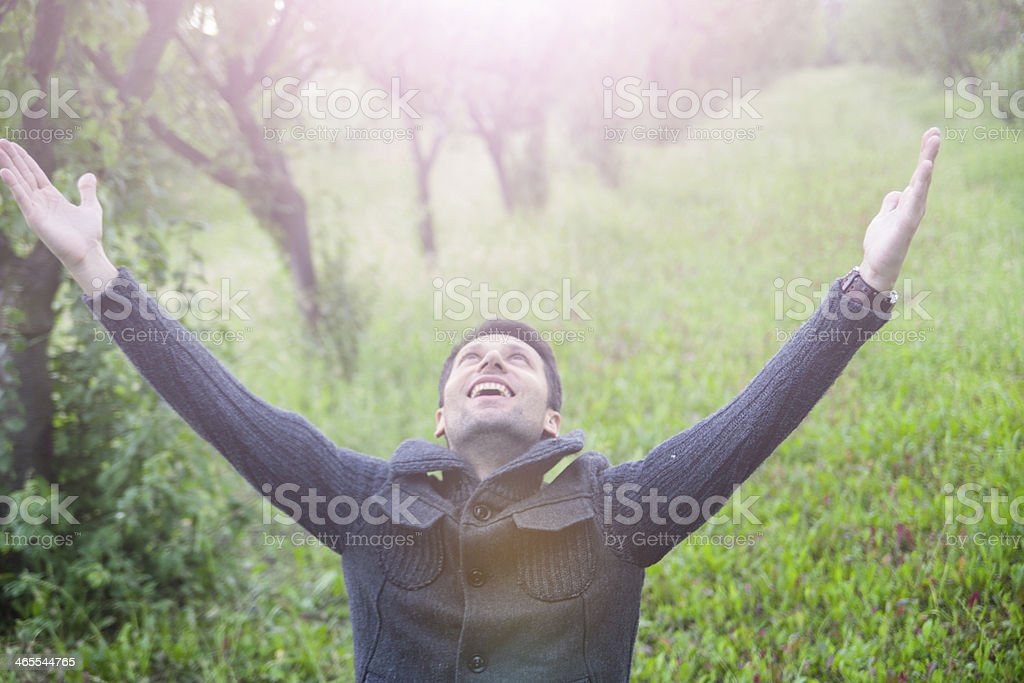 man with open arms looking up stock photo
