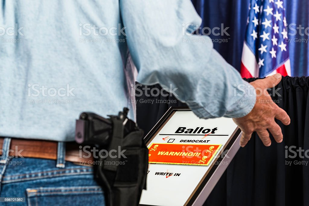 Man with open-carry handgun in holster reacting to voting hack stock photo