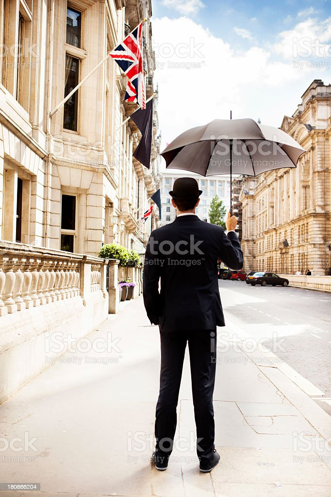 Man with opened umbrella looking at the city royalty-free stock photo