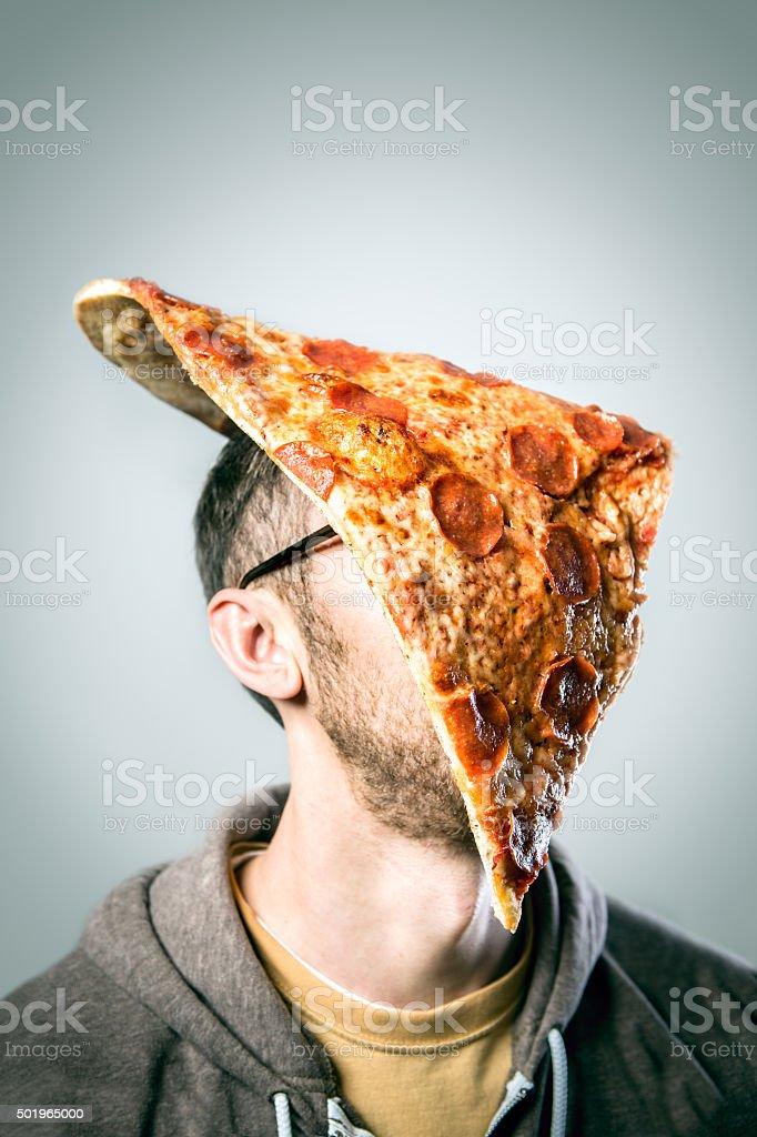 Man with Oversized Pizza Slice on Head stock photo