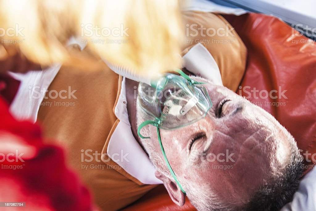 Man with oxygen mask inside the ambulance royalty-free stock photo