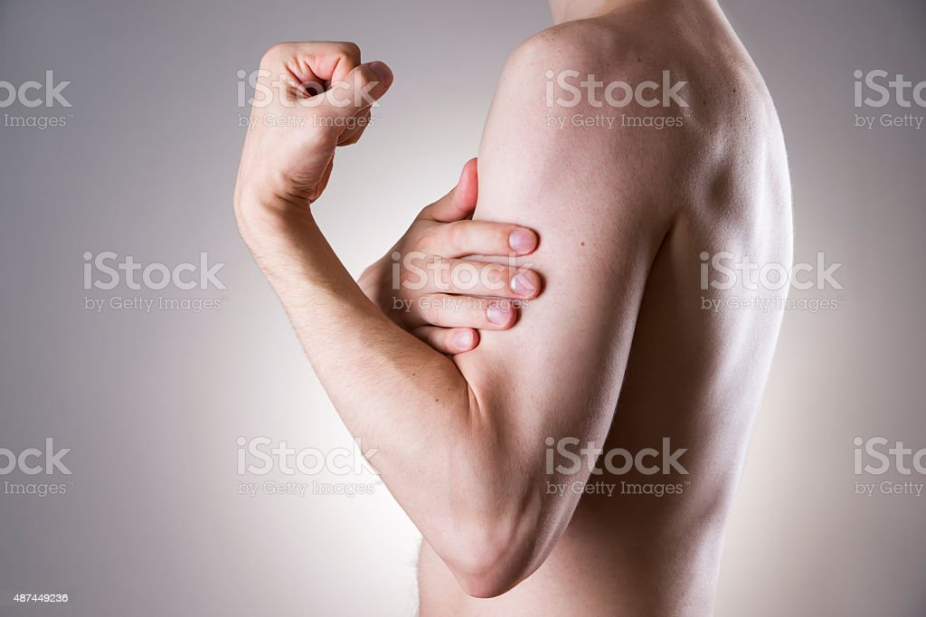 Man with pain in arm. Pain in the human body stock photo