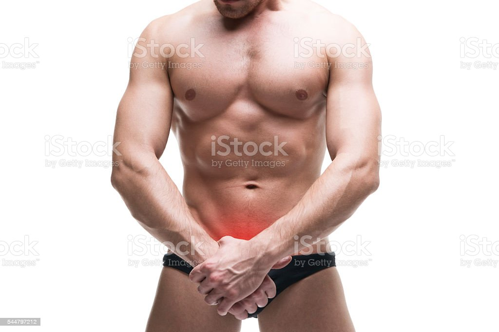 Man with pain in the prostate isolated on white background stock photo