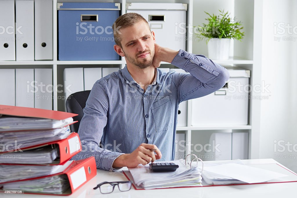 Man with pain of the cervical stock photo