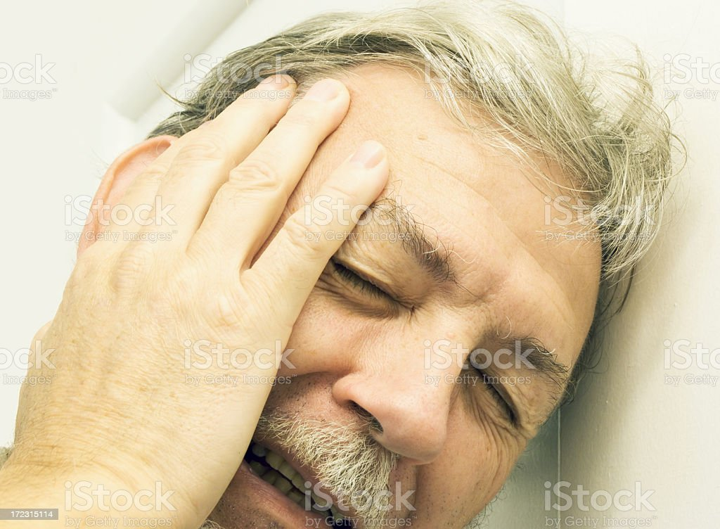Man with painful headache or depression stock photo
