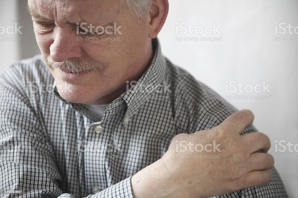 man with painful shoulder joint stock photo