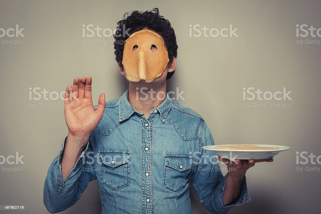 Man with pancake on his face stock photo