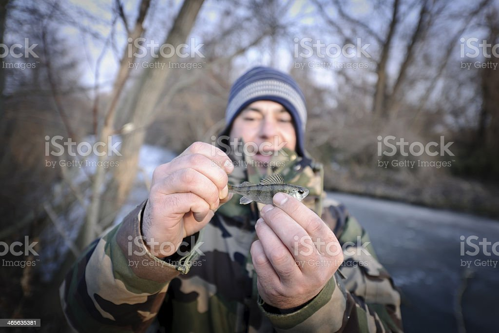 man with perch royalty-free stock photo