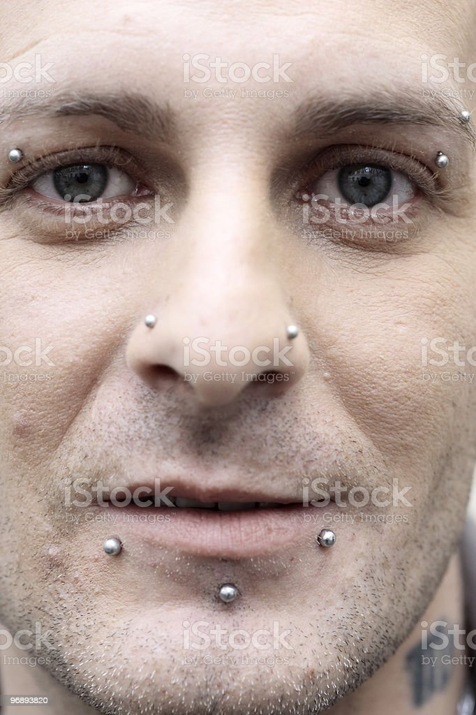 man with piercing and tattoos royalty-free stock photo