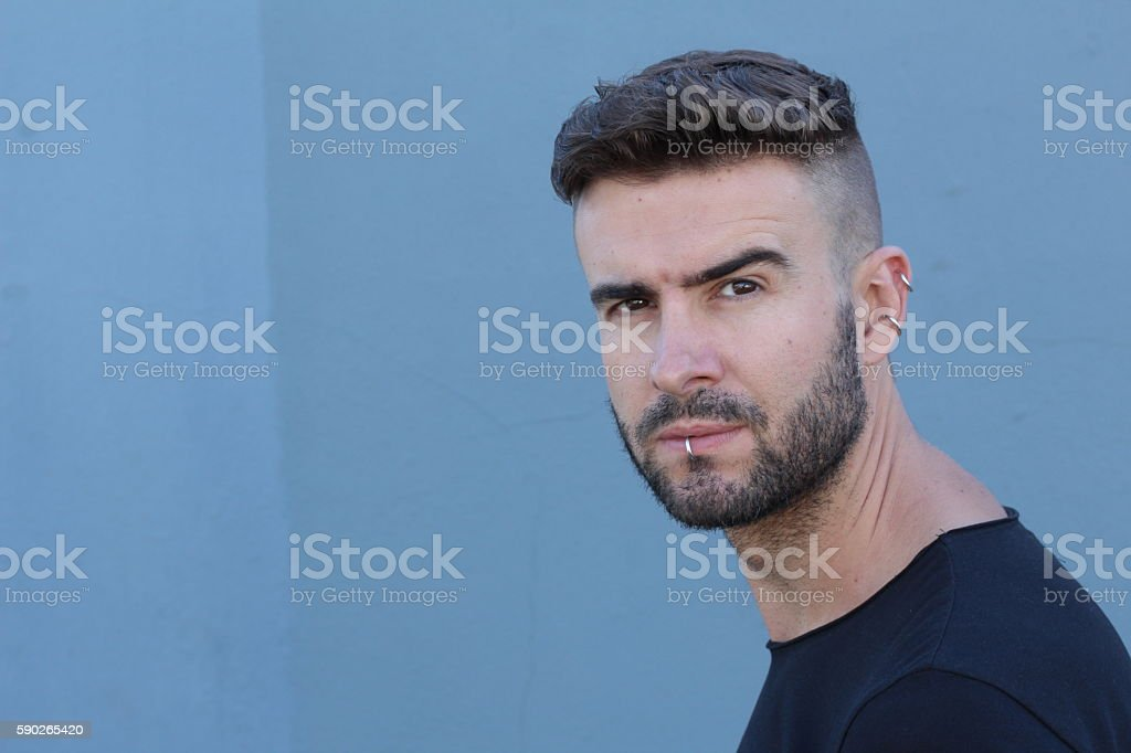 Man with piercings and radical haircut stock photo