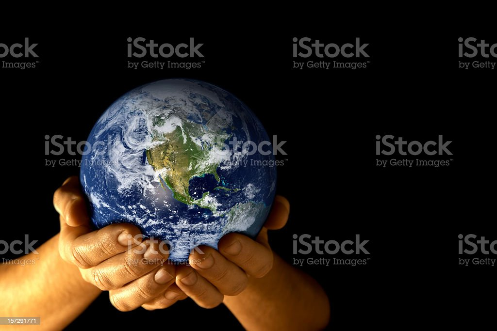 Man with planet earth in hands royalty-free stock photo