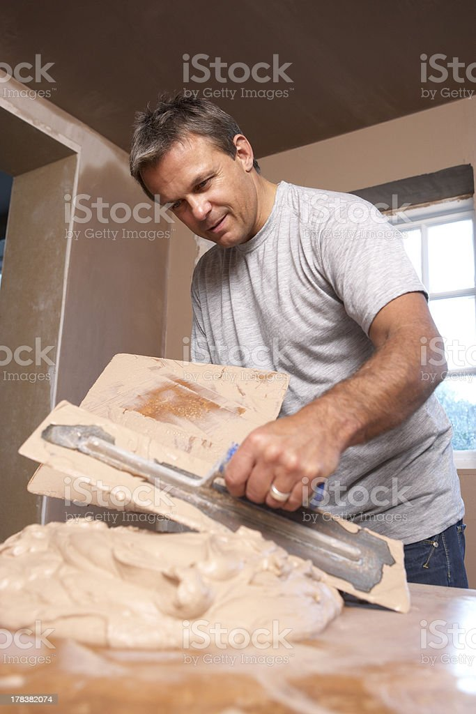 Man with plaster and tools royalty-free stock photo