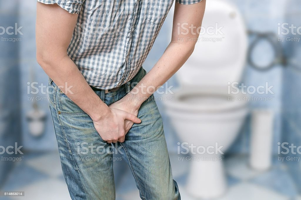 Man with prostate problem. Incontinence concept. stock photo