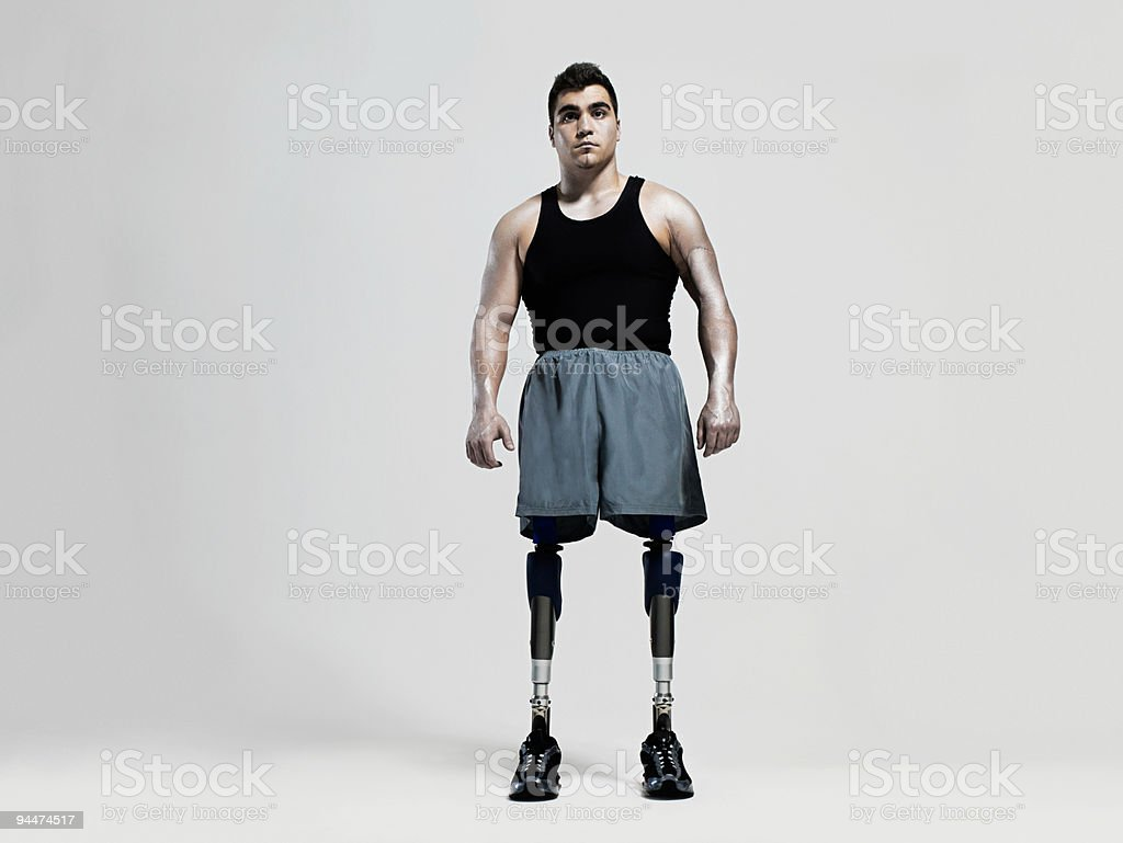 Man with prosthetic legs stock photo