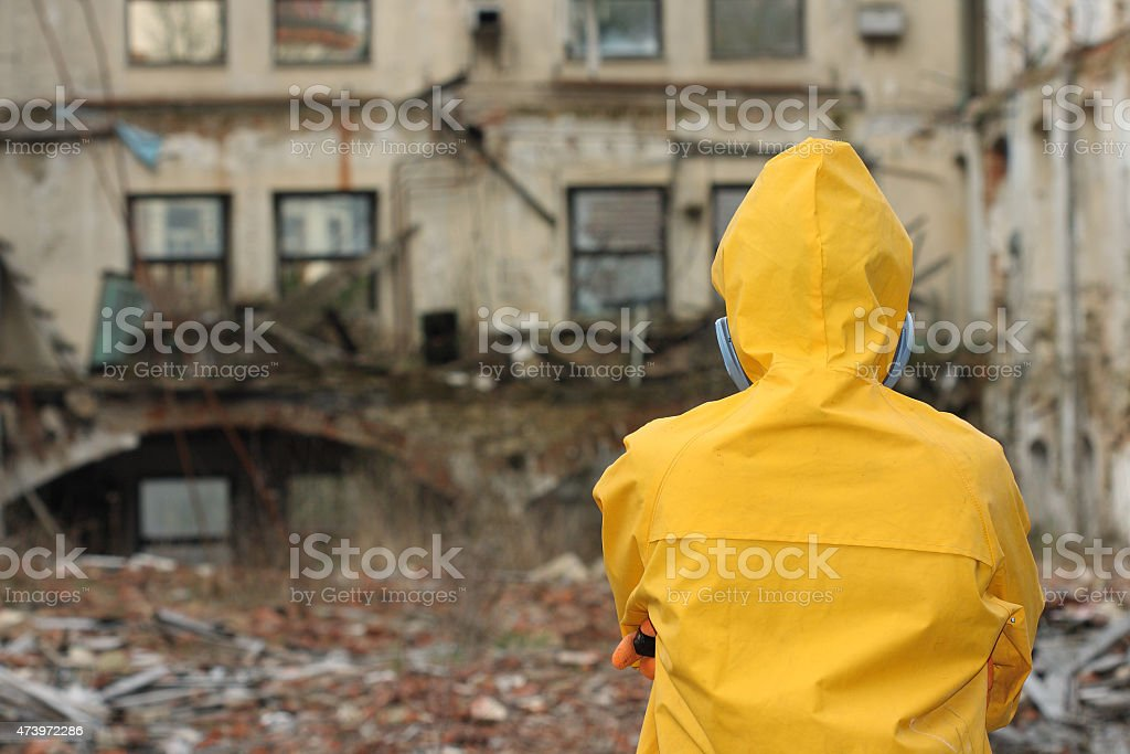 Man with protective  mask  explores danger area stock photo
