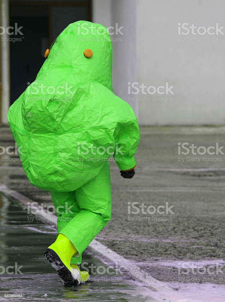 man with protective suit against biological risk stock photo