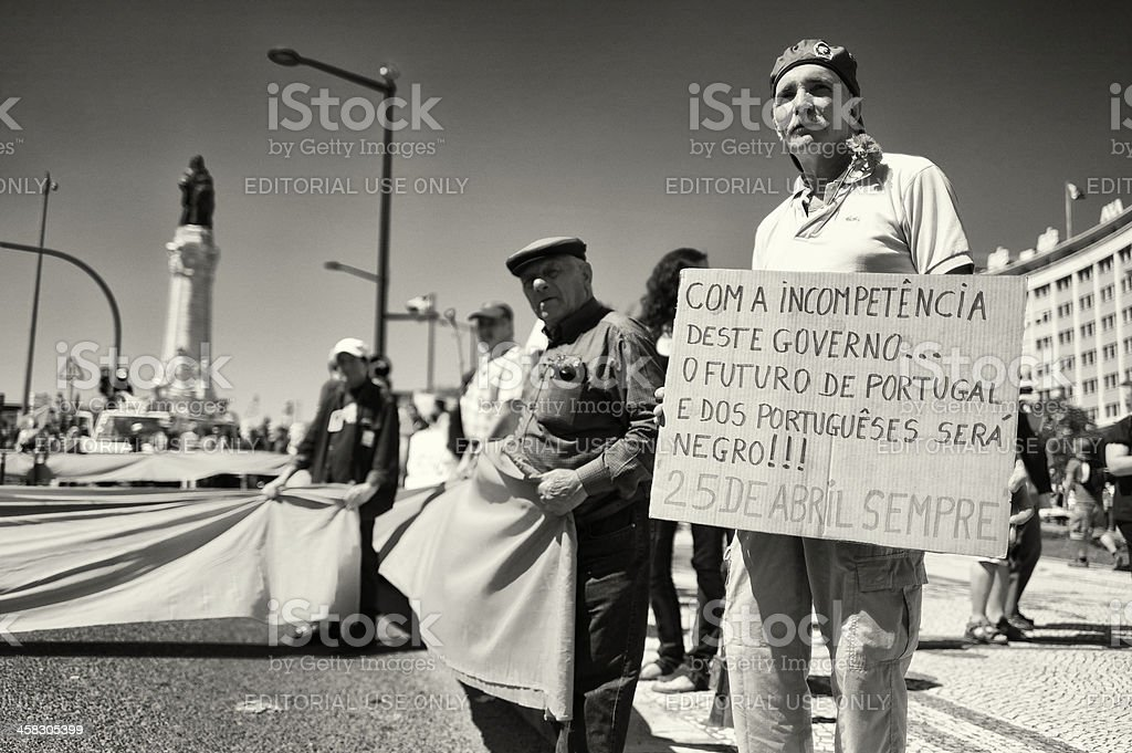 Man with Protest Sign in Lisbon royalty-free stock photo