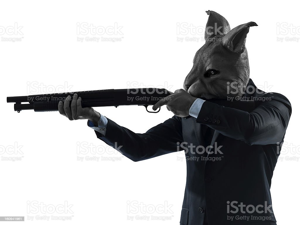 man with rabbit mask hunting shotgun silhouette portrait royalty-free stock photo