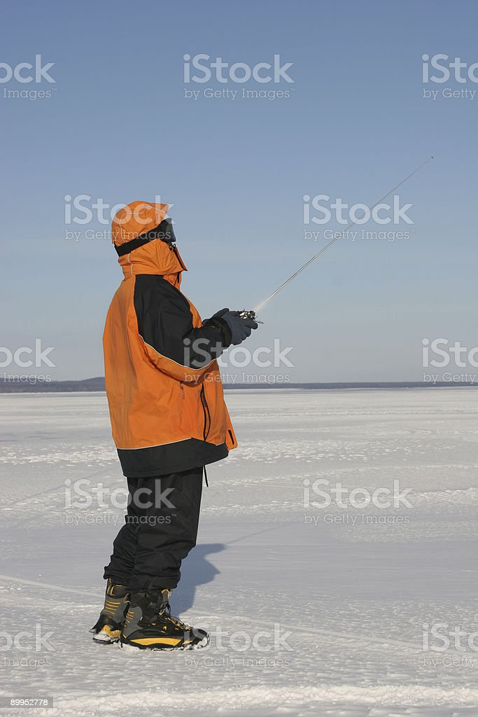 Man with radio control dressed for winter weather royalty-free stock photo