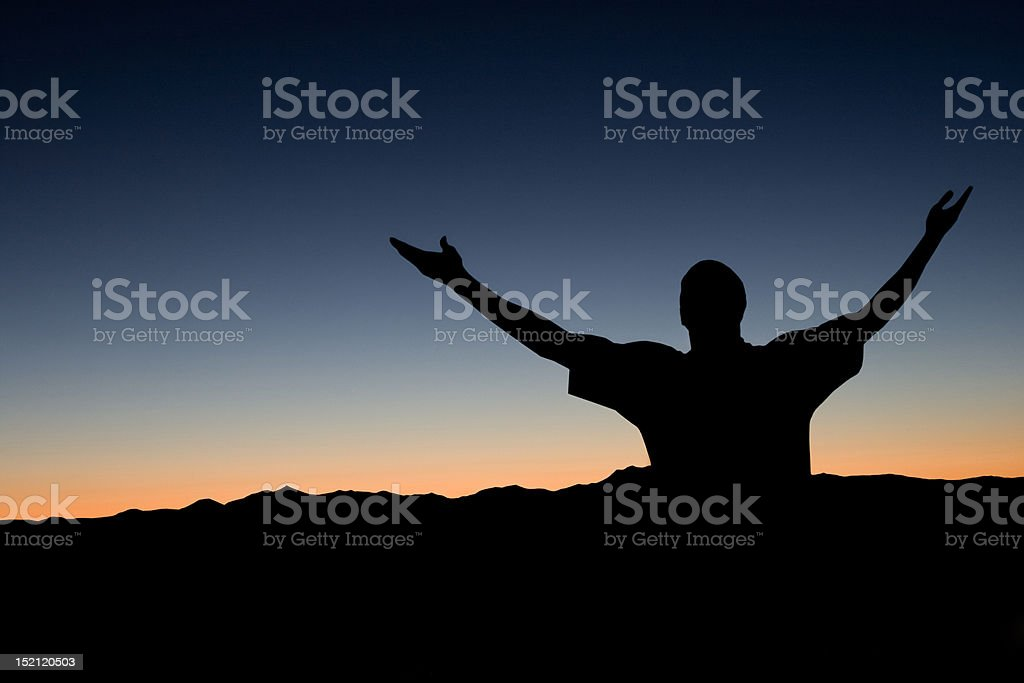 Man with Raised Arms stock photo