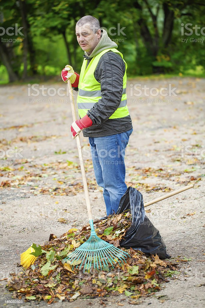 Man with rake stock photo