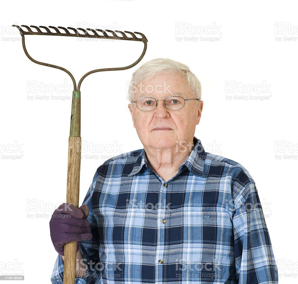 Man With Rake - Serious stock photo