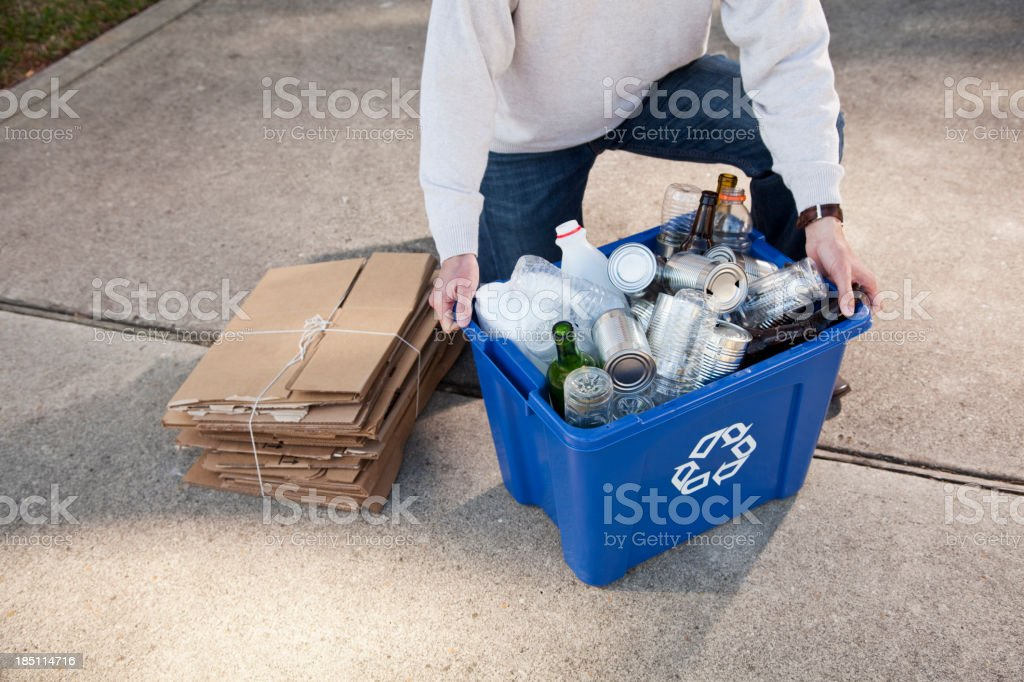 Man with recycling bin, cropped stock photo