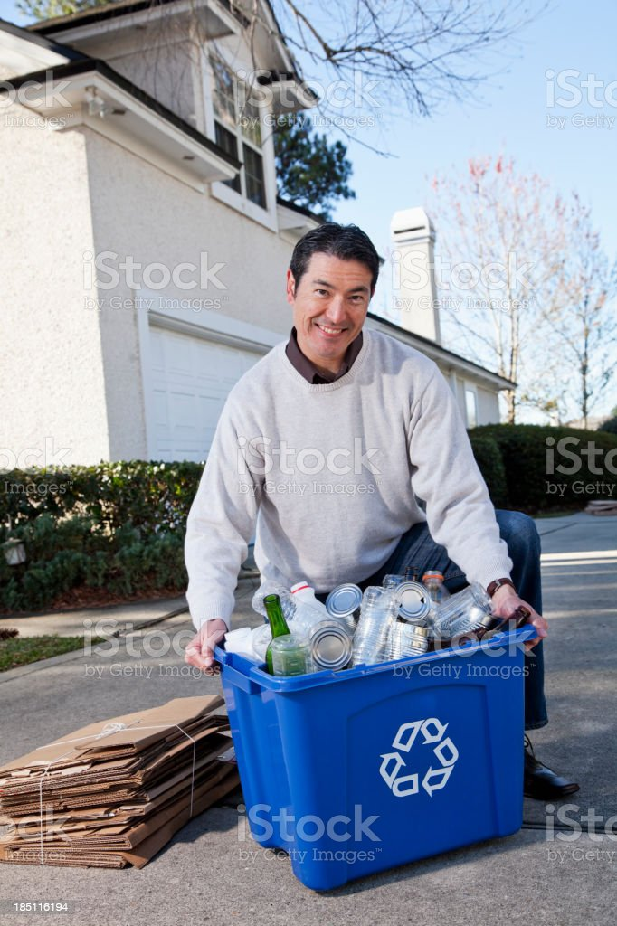 Man with recycling bin stock photo